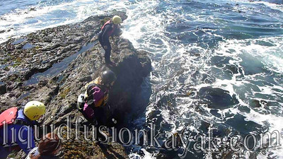 Cate and Amy coasteering on the Mendocino Coast.