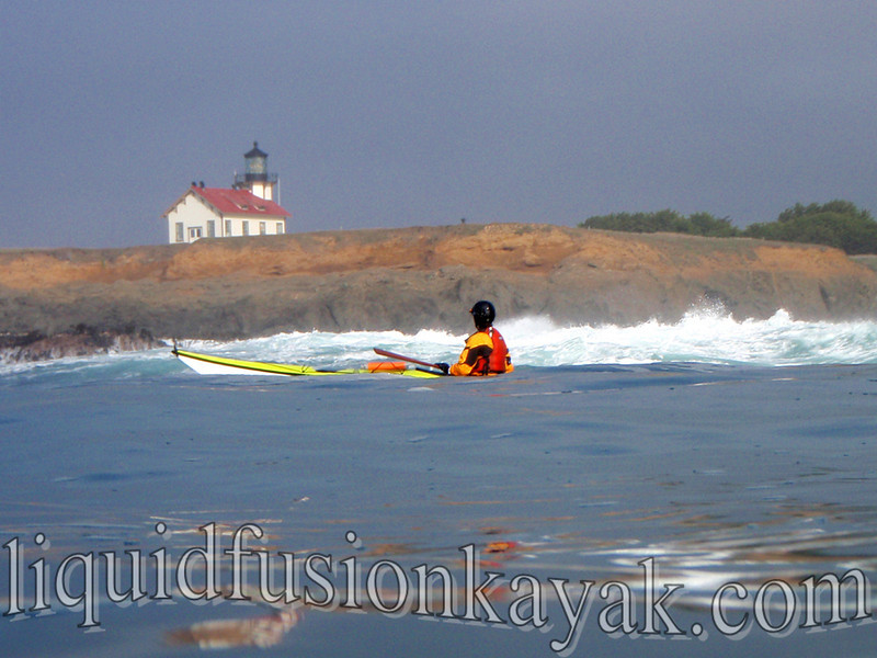 Sea kayaking past the Point Cabrillo Lighthouse