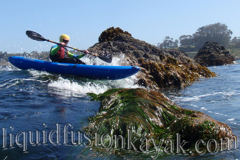 Mendocino kayaking in the ocean near Fort Bragg, CA.